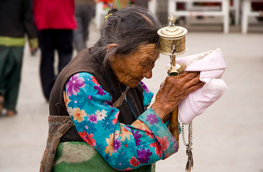 Old Tibetan Woman Praying