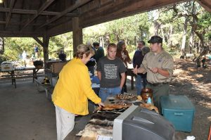Image credit: FL Guests speaking with interpreter taken by vastateparksstaff under Public Domain.