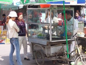 Image credit: China - Beijing 19 - our favorite breakfast stall taken by McKay Savage under Public Domain.