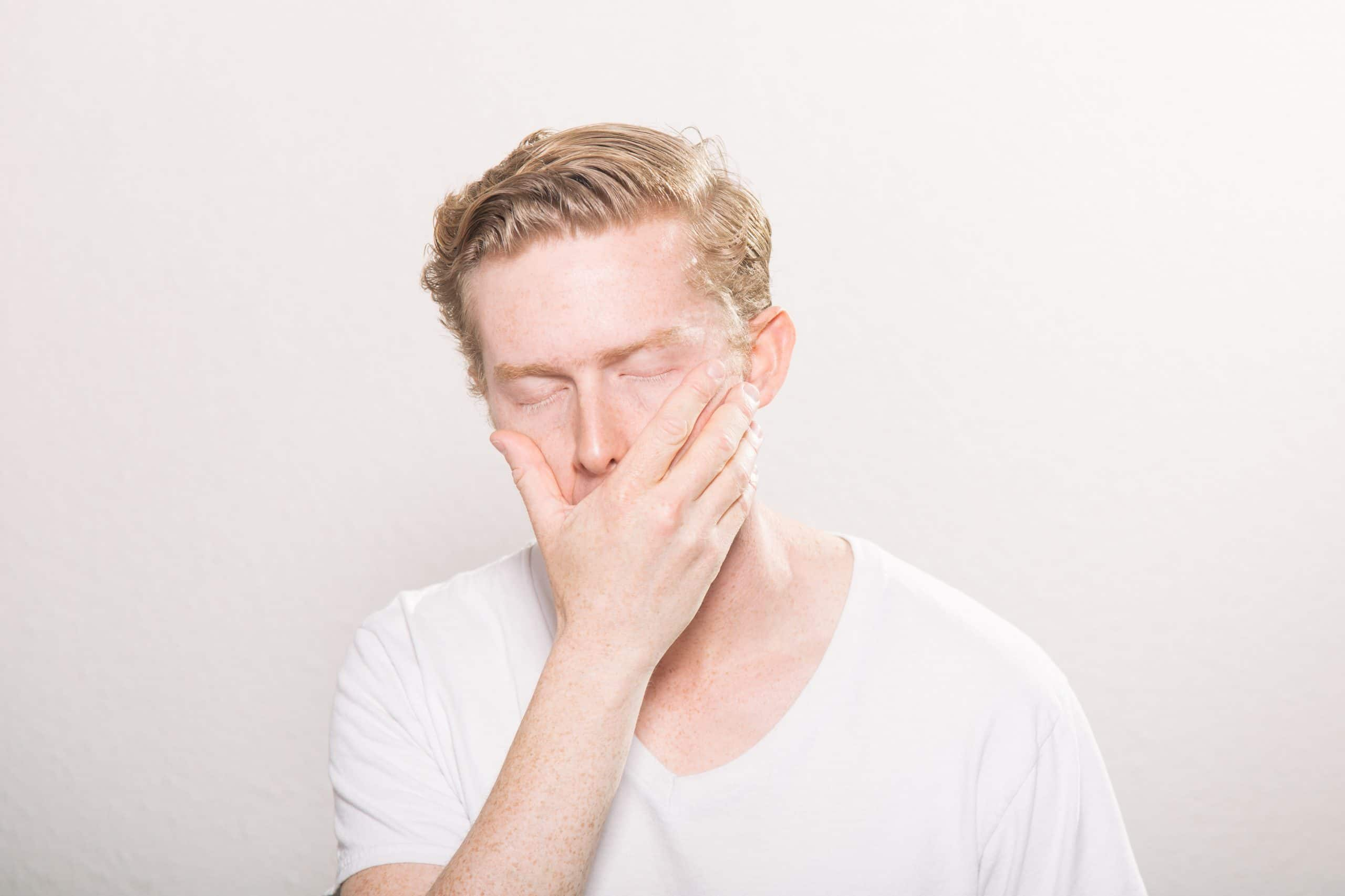 frustrated-blonde-man-white-background