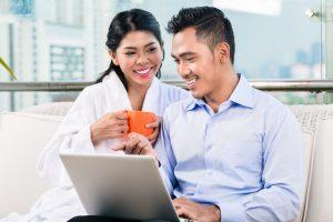 Man Using Laptop While Talking To His Partner