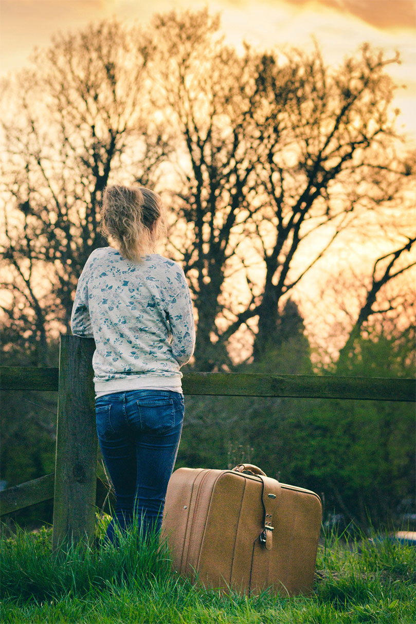 Young Girl With Luggage
