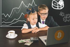 kids using laptop seeking to understand bitcoin online