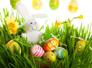 easter bunny stuffed toy and easter egss as one of the symbols of easter