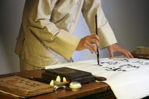 a chinese calligrapher at work
