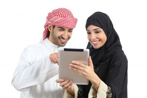 arab couple using tablet teaching anyone who wants to learn arabic