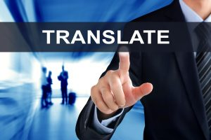 businessman pushing the translate bar