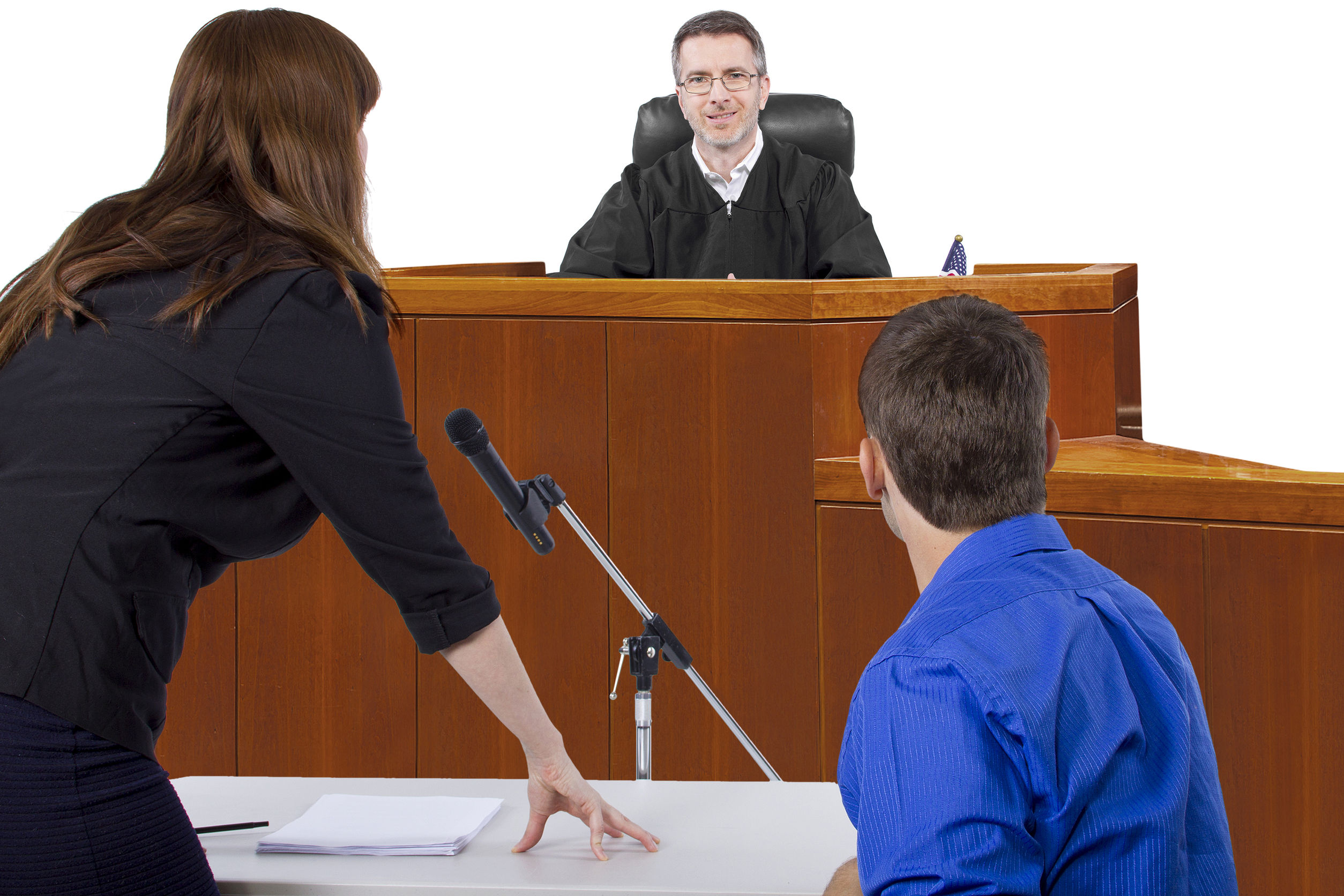 defendant with lawyer speaking to a judge in the courtroom