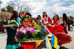 participants of the International Romani Day perform Romany folk dances in the city center