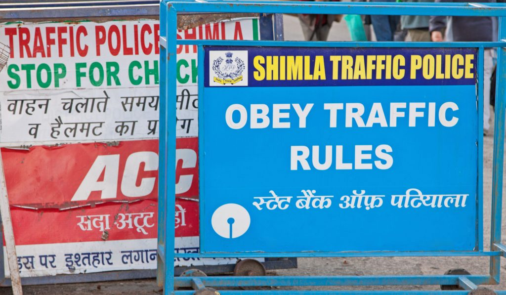 Traffic police signage in English and Hindi giving instructions to drivers in Shimla, northern India