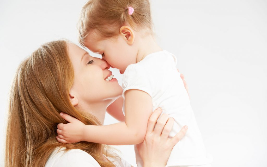 daughter kissing and hugging mommy for mothers day
