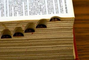 old dictionary with page open, showing side tabs