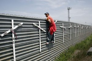 Aspiring migrant from Mexico into the US at the Tijuana-San Diego border