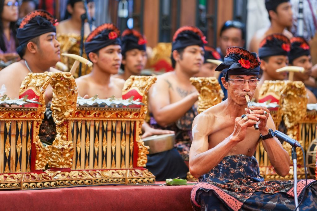 Old musician man of traditional Gamelan orchestra dressed in Balinese style
