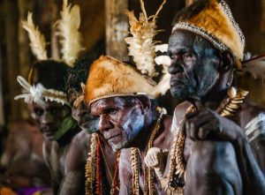 Portrait of a Warrior Asmat tribe in traditional headdress