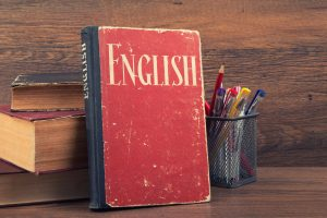 red english language book on a wooden background