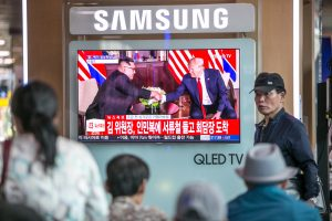 trump-kim meeting being watched by civilians on television