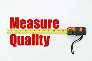 Measuring tape over the words measure and quality