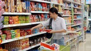 chinese lady buying snacks in a grocey store