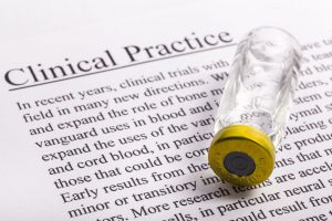 empty vial over a clinical practice documentation sheet