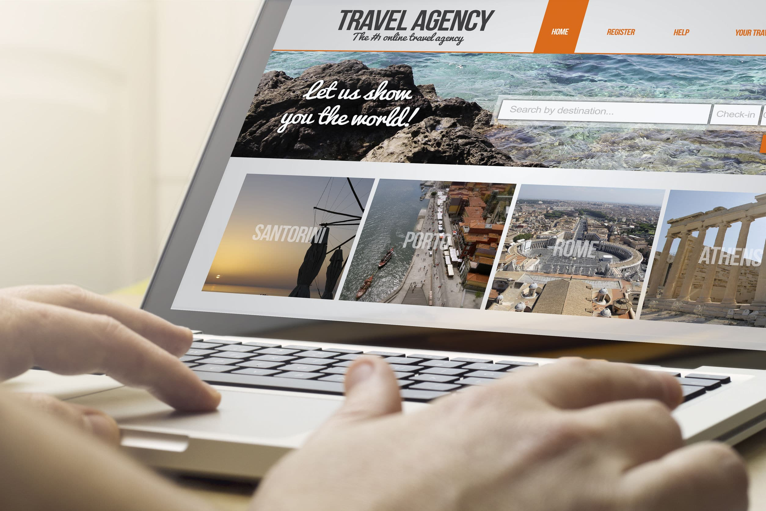 man using a laptop browsing travel agency website