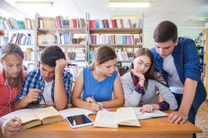 students doing group study in the library