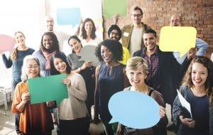 Diverse People Holding Communication Speech Bubble