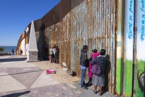 Mexican families meet at the border wall in Playas de Tijuana