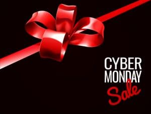 cyber monday sale red gift bow in a black background