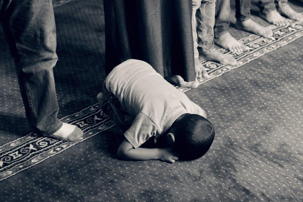 young boy in prayer