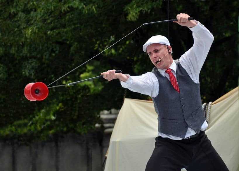 Australian performer juggling a red Diablo at the World Buskers Festival at Christchurch, New Zealand