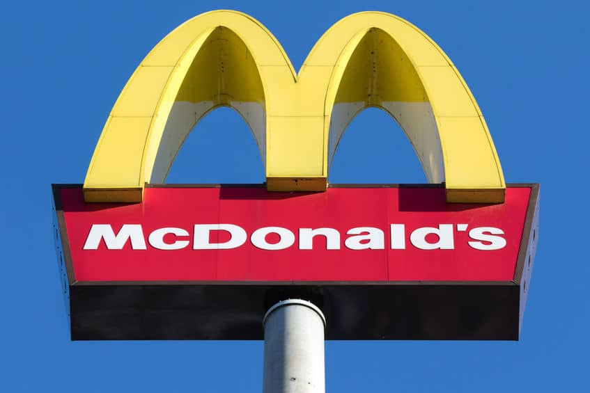 McDonald's golden arches against the blue sky