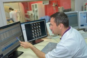 Medical Technician analysing scanner results to avoid medical interpreting errors