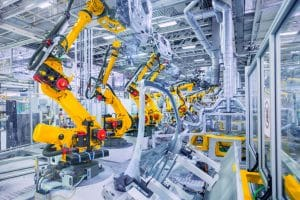 robotic arms in a car plant manufacturing industry