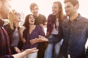 Interpreting humor - group of friends spending joyful time together talking