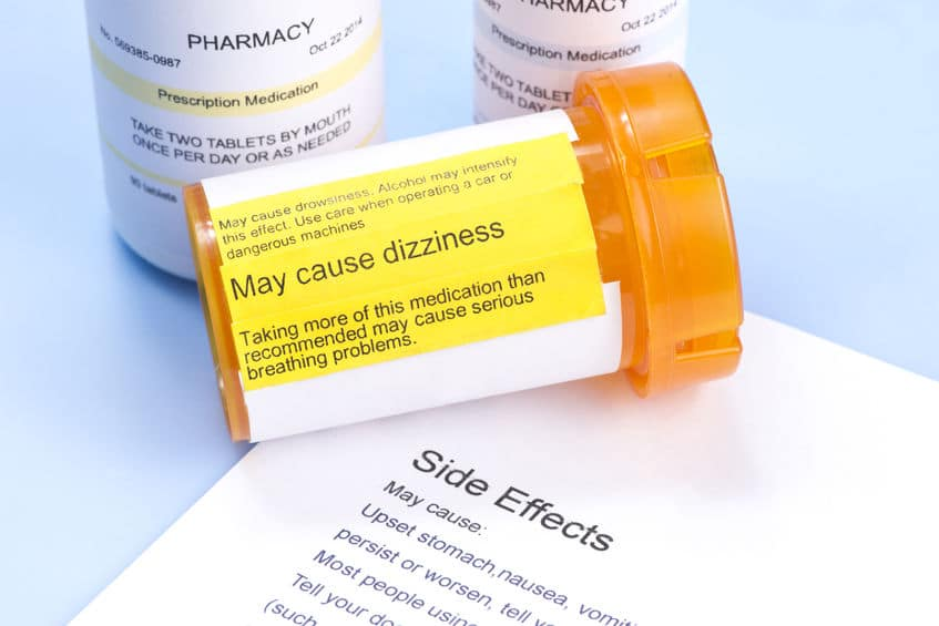 Prescription bottle with warning label and drug side effects print out to avoid mistranslated prescriptions
