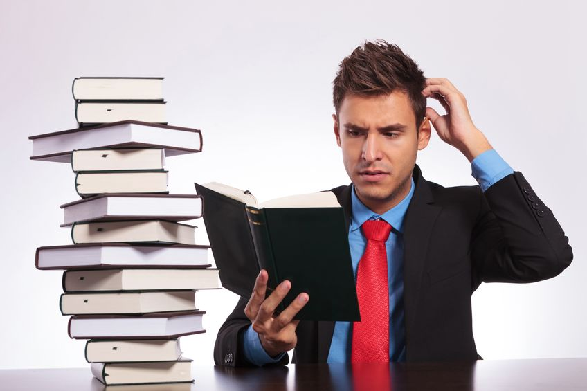 business man confused reading English words