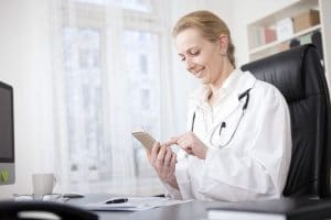 female doctor using the DayInterpreting app to book an interpreter for a patient