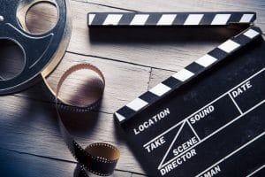 film translations - clapper and film reel