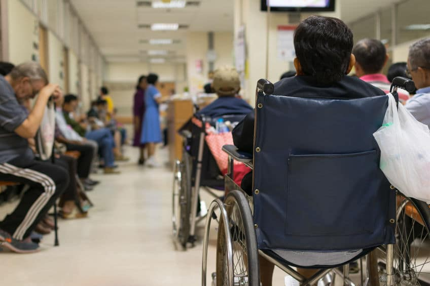 elderly patient on a wheelchair waiting for her turn for medical care