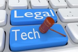 judge gavel over a legal tech button on keyboard