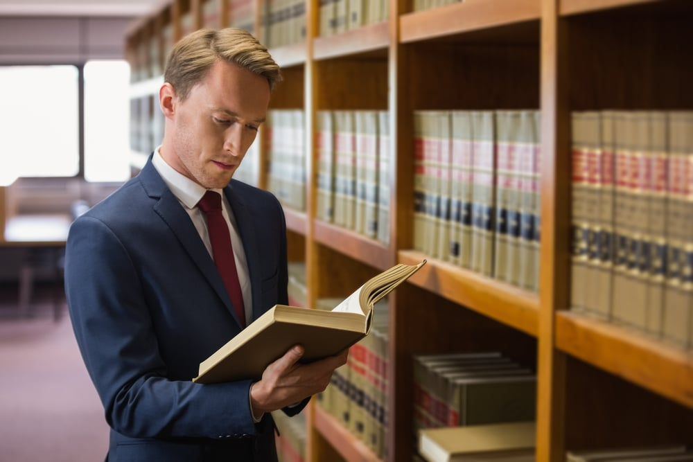 lawyer reading legal books inside his law office