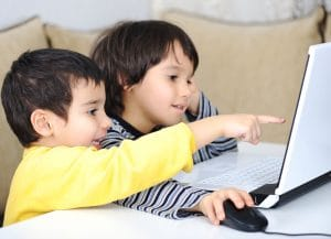 Children using laptop to play games