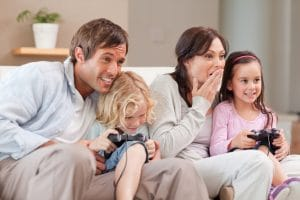 family playing a video game for bonding moments