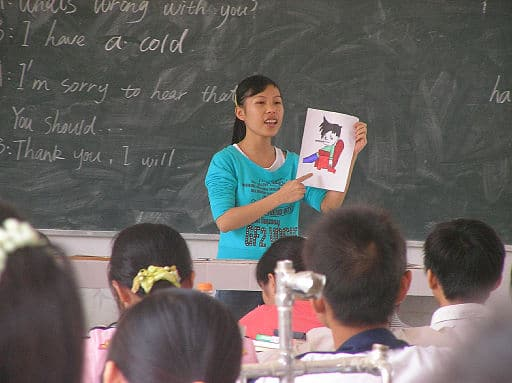 Chinese Language Teacher Teaching English To Grade School Children