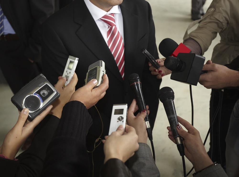 businesman being interviewed by journalist
