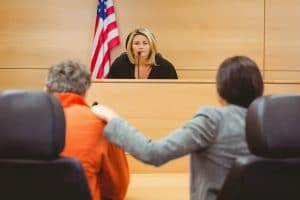 legal interpreting services in action - legal counsel interpreting the judge sentence to a prisoner