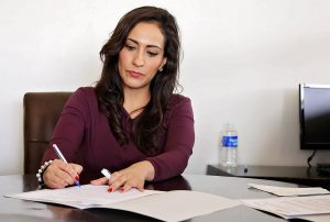woman-translating-documents