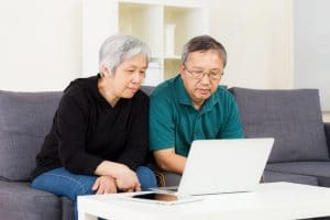 asian-couple-buying-online