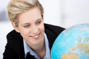 close-up-of-woman-looking-at-a-globe
